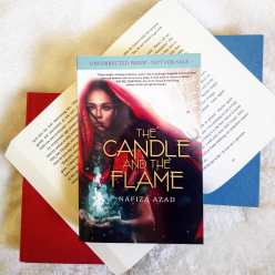 Q: What are some of your favourite book covers?  When beautiful book mail shows up at your door, you must have a photoshoot.  It's the law.  I don't make up the rules.  THE CANDLE AND THE FLAME by @nafizaaz has been on my radar for months now. The synopsis was super intriguing and then the cover was revealed and my eyeballs literally became heart-shaped that day. 😍 = me.  It's a tale of magic and strength on the Silk Road. I couldn't be more excited!  Thanks you so much @scholasticcda for the ARC!!! #thecandleandtheflame #nafizaazad #bookstagram #reader #books #yafantasy #fantasy #youngadultbooks #magic #bookishcanadians